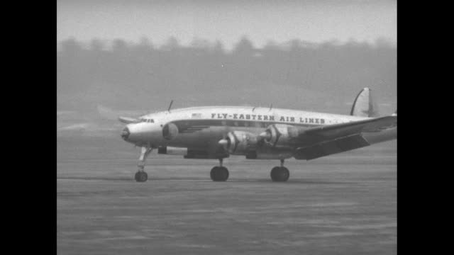 Three shots of plane carrying Dwight Eisenhower US presidentelect arriving at airfield / two shots of crowd of reporters and photographers in front...