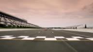 Three stock-car drivers cross finish line (Head-On)
