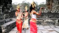 Three traditional Cambodian Apsara dancers perform at Angkor Wat in Siem Reap, Cambodia.