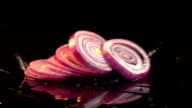 Three videos of falling sliced onion in real slow motion