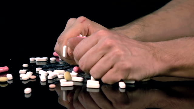 Three videos of grabbing pills in real slow motion