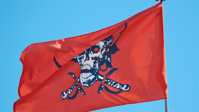 Three videos of red pirate flag in 4K