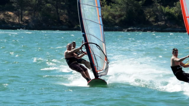 HD: Three windsurfers in the slalom action