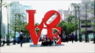 WS T/L Three woman behind love shape sculpture / Taipei, Taiwan