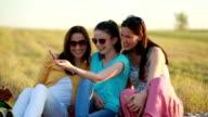 Three women taking selfie outdoors