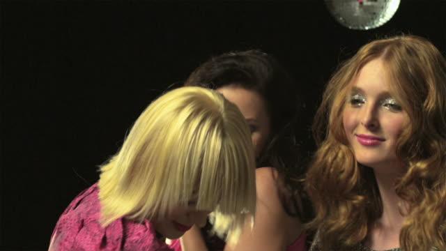 Three young women dancing, slow motion