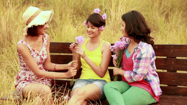 Three young women enjoying in the forest, Delhi, India