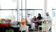 Three-generation Emirati family at cafe