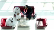 Three-generation Emirati family on the lounge
