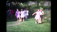 1963 three-legged race at birthday party
