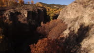 LOW through valley THOUGH TREES down RIVER,Valley, Foliage, Fall colors, Autum, Travel, Rock Spire, beautiful, Forest, Aerial, 4K California, Stock Video Sale 4K Nature/Wildlife/Weather Drone aerial video
