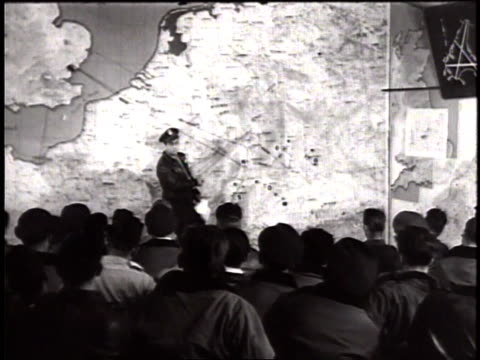 Thunderbolt pilots of USAAF sitting in war room receiving briefing for mission / United Kingdom