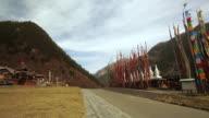 Tibetan Prayer Flags and Building in Jiuzhaigou Valley, Sichuan, China