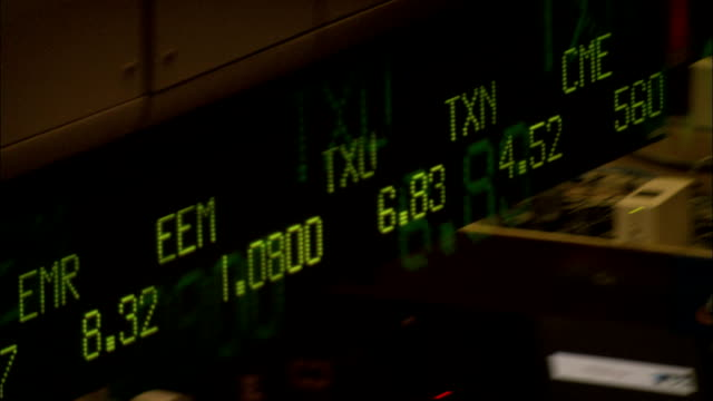 A ticker board displays stock data. Available in HD.
