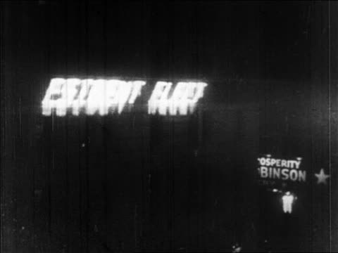 B/W 1928 ticker board reading 'president elect' in Times Square at night / New York City / newsreel