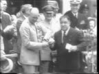Ticker tape and streamers / City Hall and crowds in square / General Dwight Eisenhower gets up from chair to acclamation of people / Mayor Fiorello H...