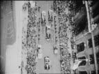 OVERHEAD ticker tape Navy Day Parade on NYC street / newsreel