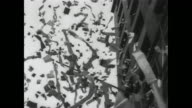 Ticker tape parade in Times Square / crowd waving huge flag in New York City