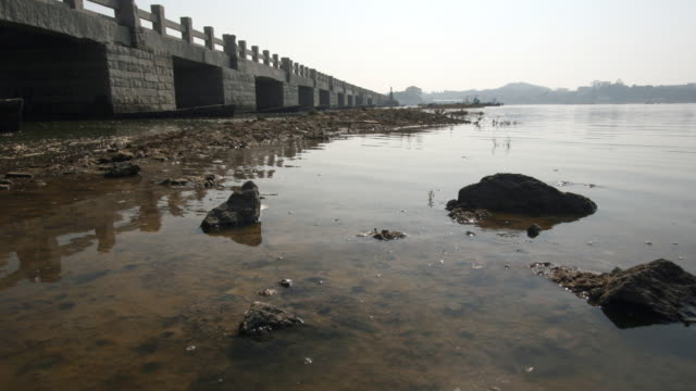 Tide rises under Luoyang bridge, Quanzhou, Fujian, China