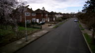 Tidy semi-detached homes line a suburban street in the Rayners Lane district of London. Available in HD.