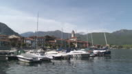 MS Tied boats at small port at Lake Maggiore / Stresa, Piedmont, Italy