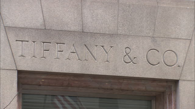 CU, Tiffany & Co. sign on building exterior, Fifth Avenue, New York City, New York, USA