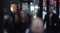 Tight shot of pedestrians and traffic in downtown Chicago. Faces blurred.
