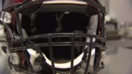 Tight shots of a red impactsensing football helmet at a Riddell testing lab in Rosemont Ill