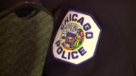 WGN Tight Shots of Chicago Police Uniform Patch at a Chicago Police Department graduation ceremony for it's newest police officers at Navy Pier on...