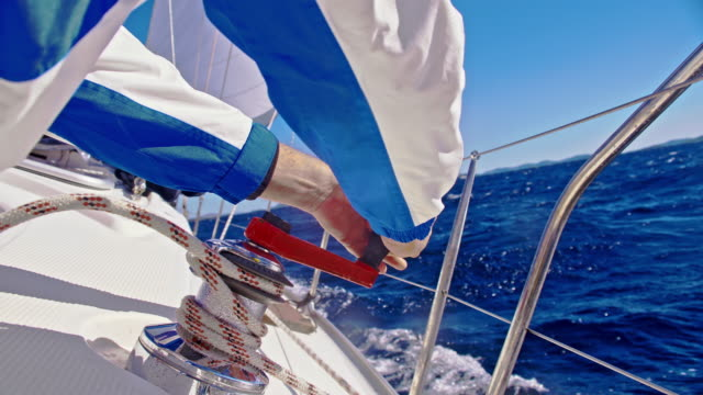 SLO MO Tightening the rope on a sailboat