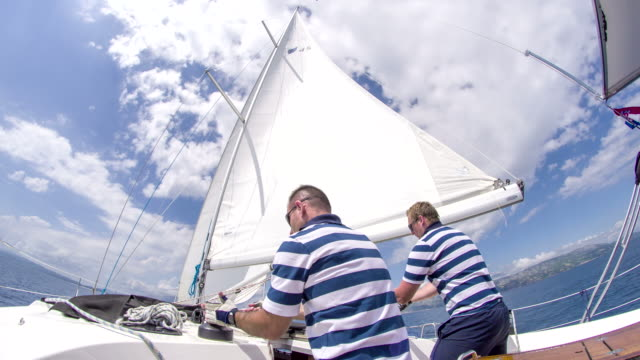 WS Tightening The Sail On A Sailboat