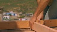 Tijuana, Mexicopounding nails into a board