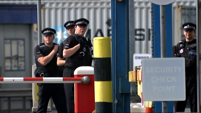 General views ENGLAND Essex Tilbury Docks EXT Sign 'Welcome to Port of Tilbury' / lorries arriving at and leaving port through Police Control area /...
