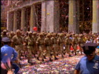 tilt down and tilt up of soldiers marching in ticker tape parade / Operation Welcome Home / NYC