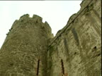 Tilt down curved tower and adjoining wall of Conwy Castle Wales
