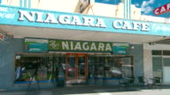"""Tilt down from awning to the shop front of the iconic historic """"The Niagara Café"""" of Gundagai"""
