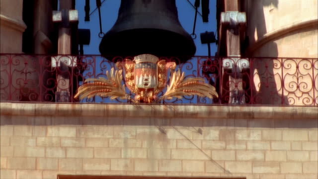 Tilt down from bell and coat of arms to clock of La Grosse Cloche at 5:52 / Bordeaux, France