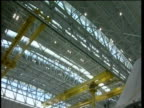 Tilt down from hangar ceiling to Airbus A380 under construction Toulouse; 18 Jan 2005