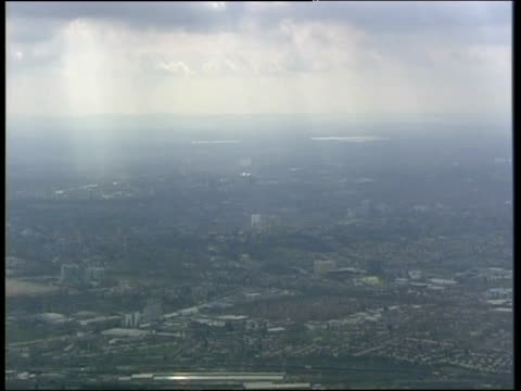 Tilt down from hazy clouds to Wembley Stadium London