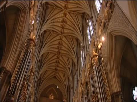 Tilt down from ornate high ceilings of Westminster Abbey