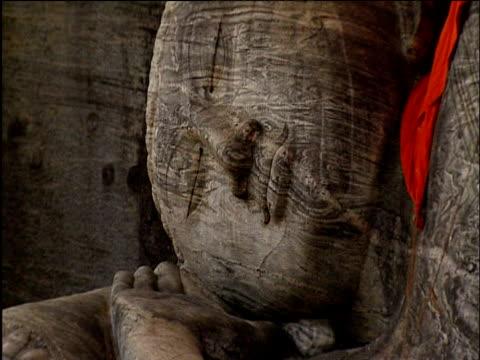 Tilt down giant Buddha of Polonnaruwa Sri Lanka