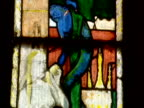 Tilt down image of Eve in stained glass window