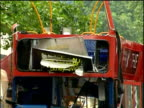 Tilt down mangled front of bus aftermath of 2005 London bombings Tavistock Square; 12 Jul 05