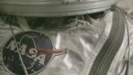 Tilt down, mannequin in vintage astronaut suit