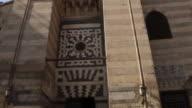 Tilt down of a building in Coptic Cairo exterior