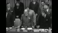 Tilt down pan delegates stand in moment of silence in memoriam for Soviet premier Joseph Stalin / Tilt down Joao Muniz of Brazil UN chairman of the...