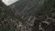 Tilt down to river in gorge, Gangotri, India Available in HD.