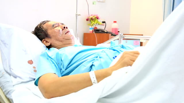 HD Tilt up crane shot: Patient in Hospital