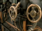 Tilt up from furnace to valves on steam train Scottish Highlands