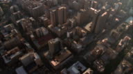 Tilt up from roofs of high rise buildings to reveal Hillbrow Tower and Central Business District stretching out beyond, Johannesburg Available in HD.